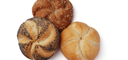 Freshly baked kaiser roll on a white background